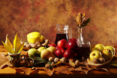 Autumn harvest: fruits, leaves and wine Stock Images