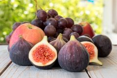 Autumn harvest with grapes, plums, figs, apples. Healthy organic fruit and vegetables. Thanksgiving organic food background Royalty Free Stock Photos