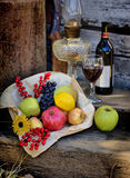 Autumn Harvest HDR. Harvest Basket filled with Fruit, Wine Bottle and Glass HDR Royalty Free Stock Images