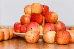 Autumn harvest of ripe apples, lots of red and yellow apples on wooden background stock images