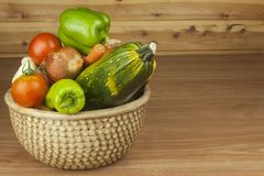 Autumn harvest vegetables. Growing organic vegetables in the country. Diet food for weight loss. Different kinds of vegetables on a wooden kitchen table Stock Photo