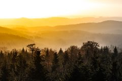 Autumn haze illuminated by sun above mountain peaks, Eagle Mountains, Orlicke hory, Czech Republic.  Royalty Free Stock Image