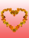 Autumn heart. From maple leaves on pink gradient background Stock Image