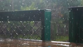 Autumn rain city place. Autumn heavy rain at city place stock footage