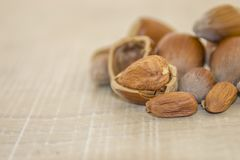 Hazelnuts on a wooden base. Autumn is here, hazelnuts in the shell and the core on a wooden surface Stock Photography