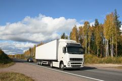 Autumn highway and white truck Stock Photo