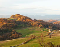 Autumn hills. Colorful autumn hills early in the morning, with small village and vineyard Royalty Free Stock Image