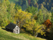 Autumn hills with old house. This picture shows the autumn hills with an old wood house Stock Photography