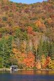 Autumn hillside and cabin Stock Photos