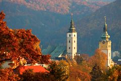 Autumn historical town. Autumn trees and historical tower buildings in Slovakia Royalty Free Stock Image