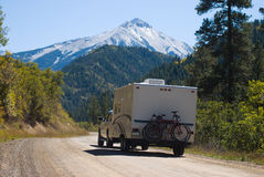 Autumn Holiday. Truck pulls a travel trailer with bicycles on Kebler Pass Road after an early snow in the high country Royalty Free Stock Image