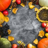 Autumn holiday concept with fallen leaves, vegetables and fruits on old table. Thanksgiving day background, Flat lay, top view stock images