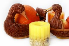 Autumn home decor. Pumpkin, apple, candle, basket in form duck Stock Image