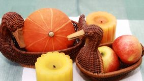 Autumn home decor. Pumpkin, apple, candle, basket in form duck Stock Photography