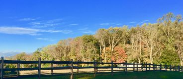 Autumn on the Horse Farm. In warmer weather, the fence would constrain several beautiful horses as they gallop through the field oute Philadelphia.  Now, though Stock Photos