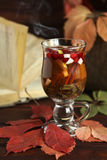 Autumn hot tea with lemon, spices in glass cup Royalty Free Stock Photography