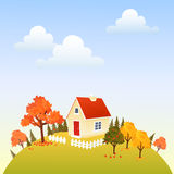 Autumn house. Cute house on autumn hill Stock Photos