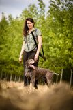 Autumn hunting season. Hunting. Outdoor sports. Woman hunter in the woods stock image