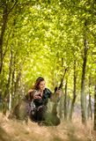 Autumn hunting season. Hunting. Outdoor sports. Woman hunter in the woods stock photography