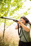 Autumn hunting season. Hunting. Outdoor sports. Woman hunter in the woods royalty free stock photos