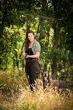 Autumn hunting season. Hunting. Outdoor sports. Woman hunter in the woods stock photos