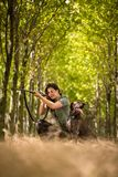 Autumn hunting season. Hunting. Outdoor sports. Woman hunter in the woods royalty free stock images