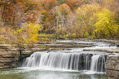 Autumn Indiana Waterfall. Lower Cataract Falls, a wide waterfall in Owen County, Indiana, is surrounded by beautiful fall foliage stock image