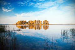 Autumn island and lake Royalty Free Stock Images