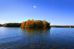 Autumn island in lake Stock Photos