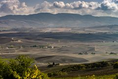 Autumn in Italy. Yellow plowed hills of Tuscany with interesting shadows and lines. Agricultural concept landscape stock photography