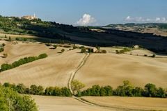 Autumn in Italy. Yellow plowed hills of Tuscany with interesting shadows and lines. Agricultural concept landscape royalty free stock photos