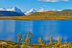 Autumn on Jack Londona's lake. Mountains in snow. Kolyma 2. Autumn on Jack Londona's lake. Mountains in snow. Kolyma. The Magadan area Stock Photography