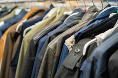 Autumn jackets. Autumn jackets in second hand shop Stock Images