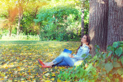 Autumn, jeans girl outside Stock Photo