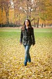 Autumn joy - young woman outdoor Royalty Free Stock Images