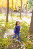 Autumn kid girl running poplar tree forest motion blur Royalty Free Stock Images