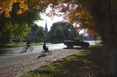 Autumn kids. Two young boys riding their bicycles in an autumn setting royalty free stock photos