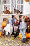 Autumn kids with pumpkin. Autumn kids - little boy and girls with pumpkin and leaves Royalty Free Stock Photo