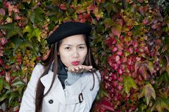 Autumn kiss from beautiful woman Stock Photography