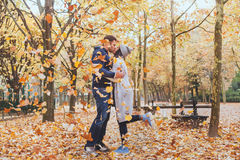 Autumn kiss, young loving couple in the park Royalty Free Stock Photo
