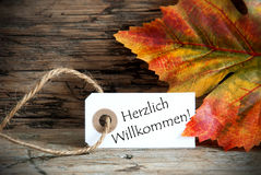 Autumn Label with Herzlich Willkommen Stock Photo