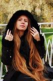 Autumn Lady. Young girl enjoying autumn landscape royalty free stock photo
