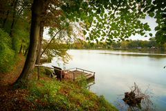 Pier on autumn lake. This is tranquil scene royalty free stock photography