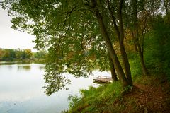 Pier on autumn lake. This is tranquil scene royalty free stock photo