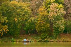Pier on autumn lake. This is tranquil scene royalty free stock image