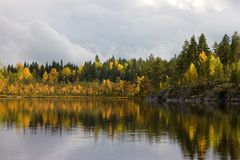 Autumn lake. With reflections on a background of clouds Stock Image