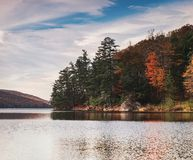 Autumn Lake. Autumnal lake under blue cloudy sky in the park Stock Photo