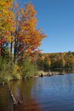 Autumn Lake. The beautiful fall colors of a northwoods forest made even more vibrant by the reflective waters of a wilderness lake stock photos