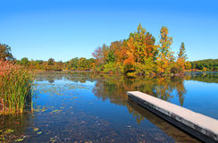 Autumn lake with boat access Stock Photos