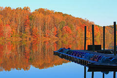 Boat Launch. Autumn lake side with recreation boats docked at launch in the morning royalty free stock image